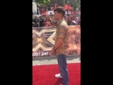 louis on the red carpet today for the second day of the x factor auditions. july 19, 2018