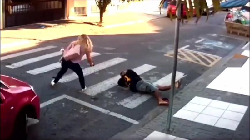 Wow! A sick man walks up to a group of women and children and tries to rob them.