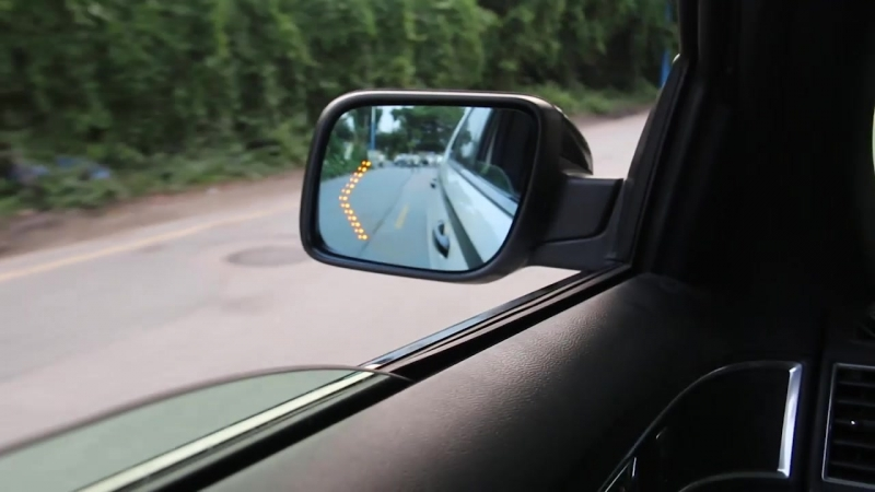 Blue Rearview Mirror with Turn Signal Light.