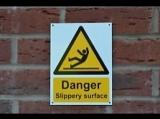 DANGER / SLIPPERY FLOOR SURFACE! (VHS Video)