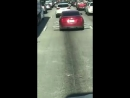 Car With Protruding Wire Rims Drives Down Highway - 986023