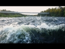 A risky flight on a drone over the water at an extremely low altitude above a stormy river