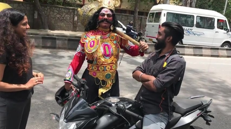 Guy dressed up as Yama(God of death), stopping all the bikers who were not wearing helmets and giving them one for free.