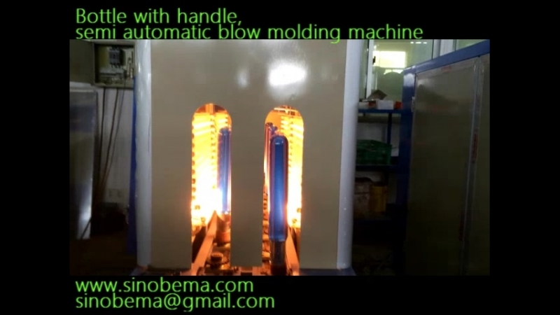 Semi automatic stretch blow molding machine To make PET bottles with handles