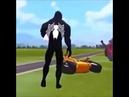 Venom stabs Spider-Man in the butt