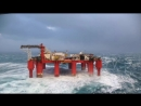 Huge waves crash against swaying North Sea oil rig (плавучая нефтяная платформа)