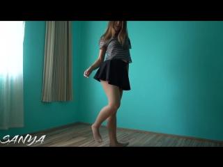 Sheer skin color pantyhose and a black skater skirt dance