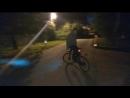 На велосипеде - задом наперёд.