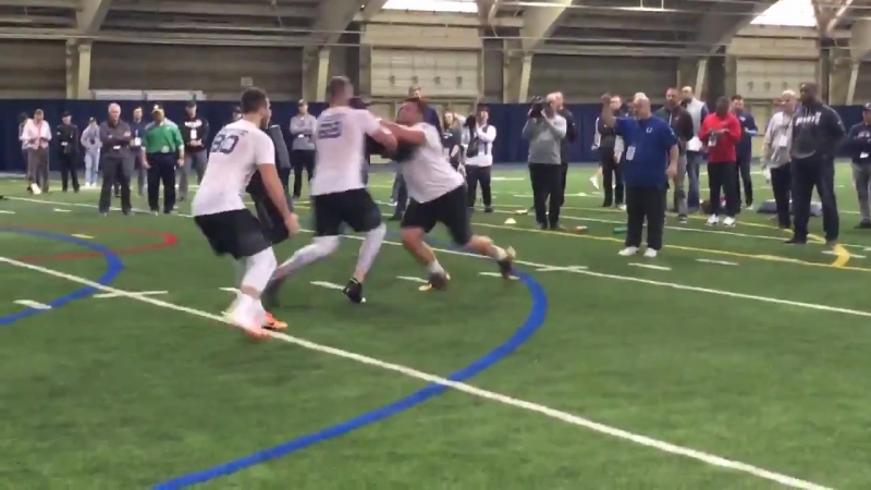 The Quenton Nelson-Mike Mcglinchey show with Colts OL coach Dave DeGuglielmo watching in the back