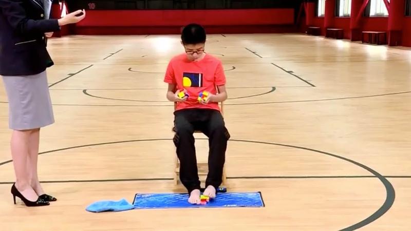 China's teen Rubik's Cube maestro breaks world record with feet