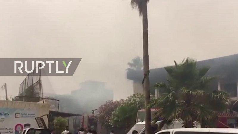 Как мимнмум 12 человек погибли в результате нападения и взрыва смертника в здании центральной избирательной комиссии в Триполи