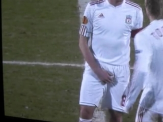 Footballer Steven Gerrard grabbing his crotch