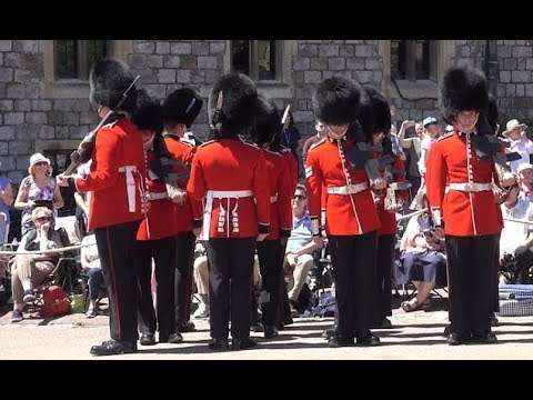 Guards get disastrously tangled up during the Garter Ceremony at Windsor