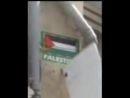 Palestine Israeli occupation Police trying to scrape off a Palestinian flag from a house in the ultra orthodox neighborhood in