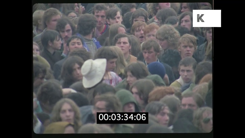 1960s, 1970s Outdoor Hippie Festival Crowd Rushes from 35mm