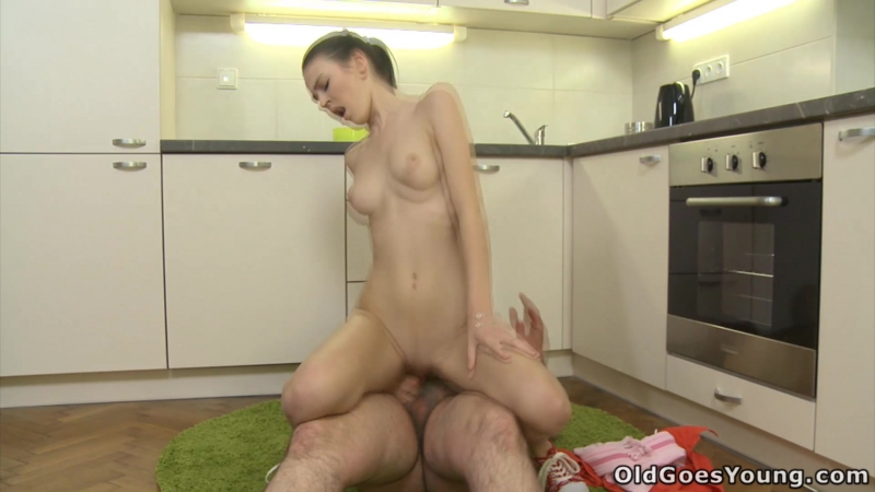Katia ( Katia kneels besides her older male lover and he shoots cum all over her young face and