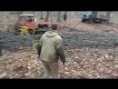 Два ГАЗ 66 вытягивают застрявший в грязи трактор ДТ