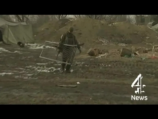 Ukraine crisis_ The people digging for food in the ruins of Debaltseve _ Channel 4 News(1)