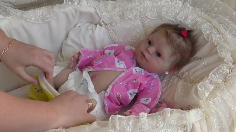 Reborn Doll drinking and pissing