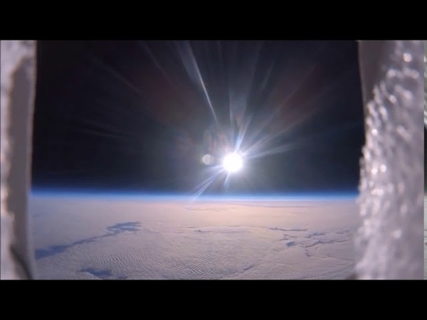 Любительская съемка с шара. Показан плоский горизонт и локализованное пятно солнца.