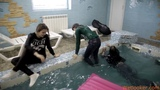 Girls are jumping in a pool and swimming in clothes!