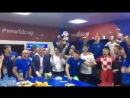 Croatian president Kolinda Grabar-Kitarović celebrates with the rest of the team in the locker room after winning the quarter-fi