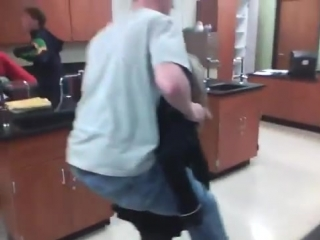 girl lifts older brother