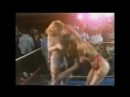 TOPLESS WRESTLER LIFTS AND SPINS HER OPPONENT