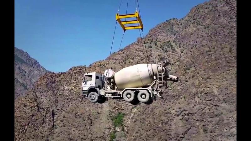 Как перемещают технику по воздуху при строительстве высотных дамб