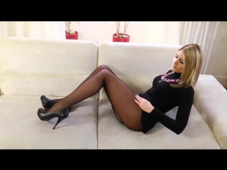 Sexy blonde in black mini dress and black tights