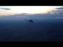 Над полигоном Цугол, раннее утро в момент восхода солнца. Перебазировка МИ-8 в неполном составе двух бортовк основному составу.