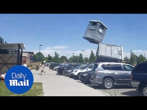 Hurricane wind sends portable loo flying in Denver, Colorado - Daily Mail