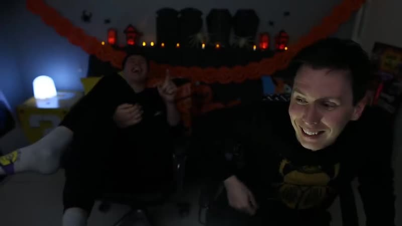 Dan pulling phil's hand away from the mouse during a jumpscare
