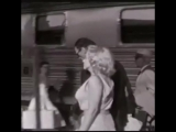 Marilyn Monroe and Arthur Miller at a train station in Washington D.C., 1957.