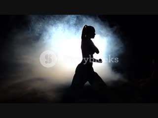 girl-athlete-shows-power-moves-black-silhouette-backlight_sctuvzmi__PM