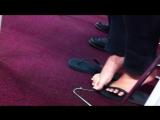 Candid Asian girl's flip flops stuck in gum