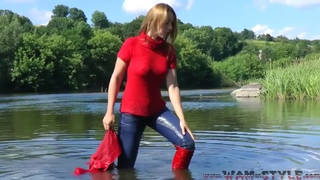 Marianna swims in the river fully clothed
