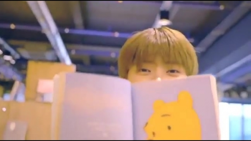 Jaehyun showing winnie the pooh picture in story book (2018)