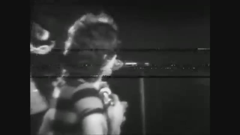 The earliest live footage of AC/DC in action. Shot in a high school in March '76, before they were even in uniform.