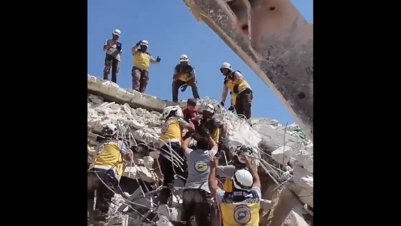 White Helmets clearly staging the rescue of two kids from under the rubble in Bab el Hawa.