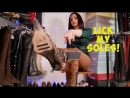 Russian girl trying on new high heels leopard boots