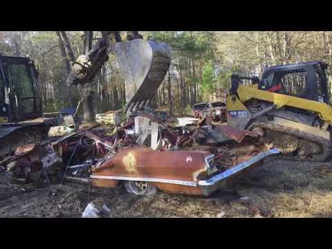 1963 chevy impala making its way to the scrap yard