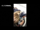 Brace!- passenger films United Airlines emergency landing