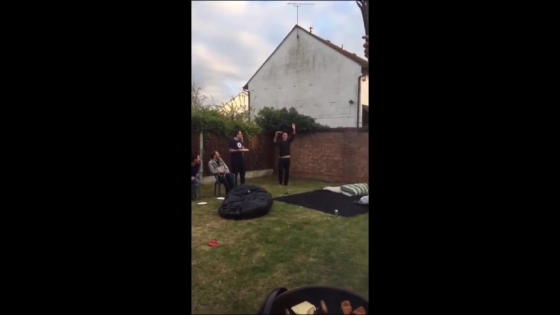 Lad throws hot dog behind him on to lads plate