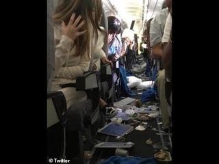 Flight from hell! Fifteen injured cabin left disarray plane hit severe turbulence.