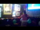 Girl pops balloons at bar