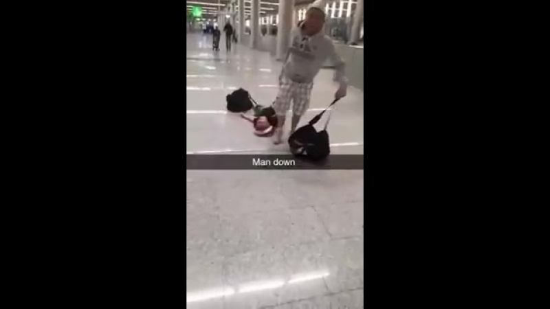 Lad being dragged through Magaluf airport