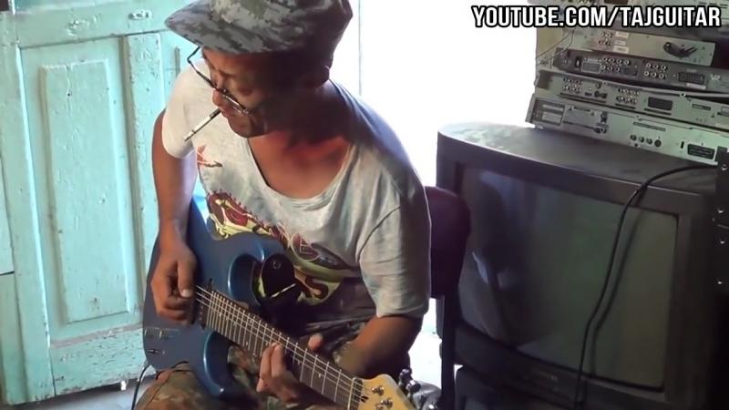 Не вынимая сигарету изо рта Россиянин- якут устроил потрясающее соло на гитаре