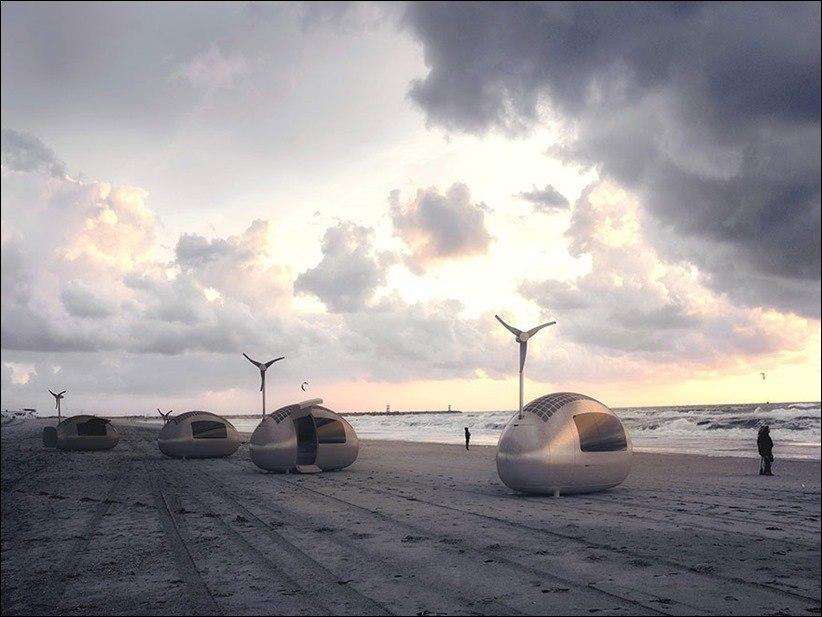 Крошечные хижины Ecocapsules с ветряком.