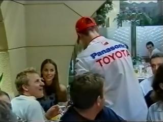 Michael Schumacher and Kimi Raikkonen after the 2003 Japanese GP
